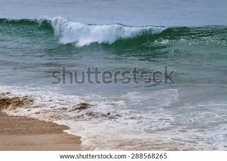 Sea waves on the sand beach. Background texture
