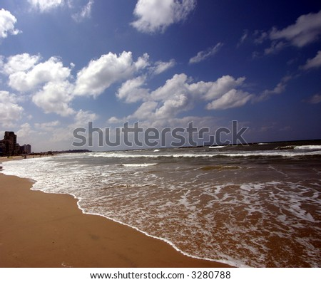 Sea waves on tropical beach - stock photo