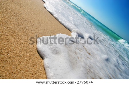 Sea waves on tropical beach in natural harmony - stock photo