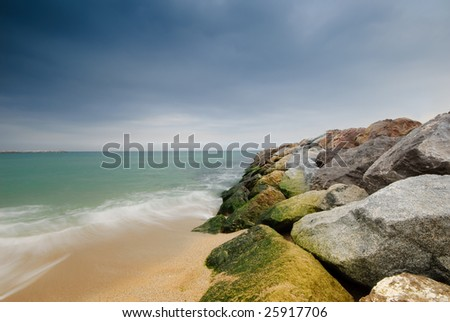 Sea waves, seen from the breakwater in Barcelona - stock photo