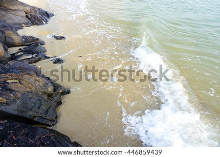 Sea,wet sand,stone,wave at beach southern Thailand on morning time before sunrise,select focus with shallow depth of field:ideal use for background. - stock photo
