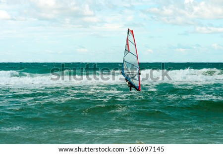 Sea Windsurfing Sport sailing water active leisure Windsurfer training on waves summer day - stock photo