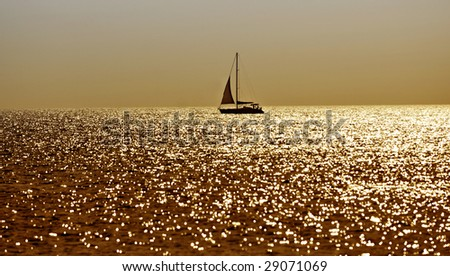 Sea with fishing boats in the evening sun - stock photo