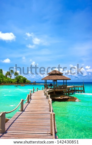 Sea with pier under blue cloudy sky in Koh Kood , Thailand
