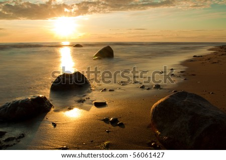 Sea with stones in nature - stock photo