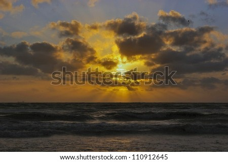 Sea with sunset at the beach in The Netherlands. - stock photo