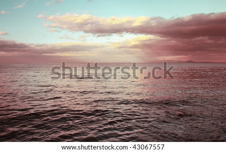 Sea with sunset clouds