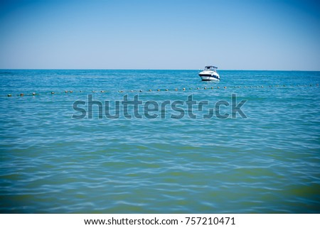 Sea with yacht