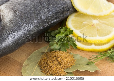 Seabass with with spices, parsley, dill and lemon isolated on white background - stock photo