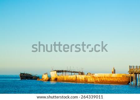 Seacliff state beach in Aptos near Santa Cruz California.  SS Palo Alto concrete ship at dock. - stock photo