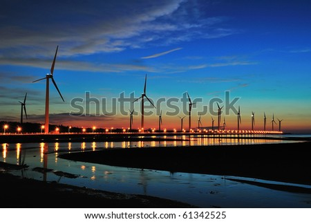 seacoast sunset with street lights - stock photo
