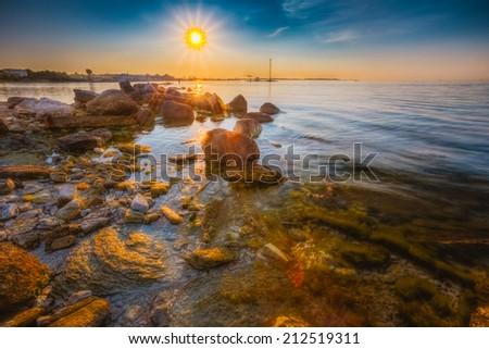 Seacost Seashore Sea Water, Coastline During Sundown In Tallinn, Estonia - stock photo