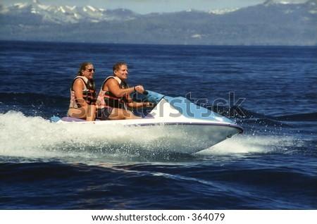 Seadoo water bike with two riders - stock photo