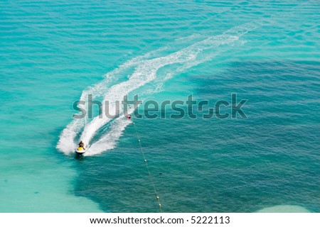 Seadoos, jetskis, and watercraft on the blue caribbean ocean at a resort hotel in cancun mexico - stock photo