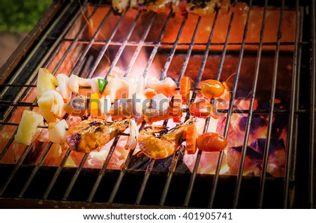 seafood and Chicken barbecue grilled on roaster and fire