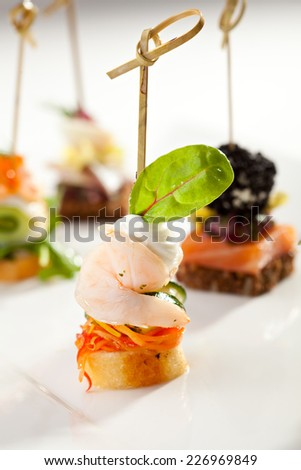 Seafood and Vegetables Canapes Dish - stock photo