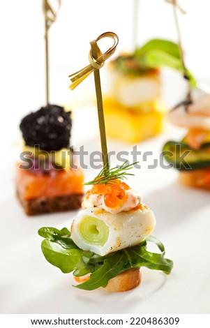 Seafood and Vegetables Canapes on White Dish - stock photo