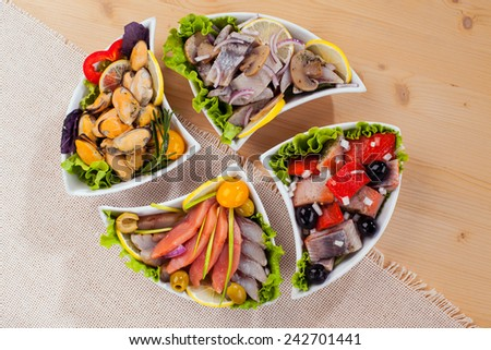 Seafood appetizer salad mussels oysters red fish mix - stock photo