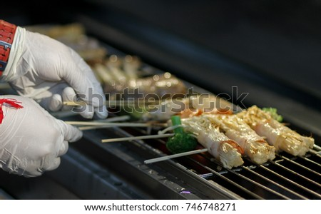 Seafood Barbeque with Marinated Sauce is burning.