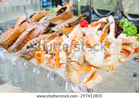 Seafood buffet line Alaska King Crab and mantis shrimp in hotel restaurant, Focus at king crab