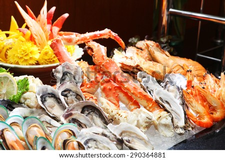 Seafood buffet line (Oyster and Alaska King Crab) in hotel restaurant  - stock photo