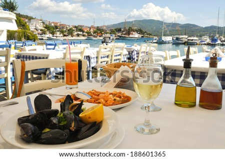 seafood dinner in a Greece resort - stock photo
