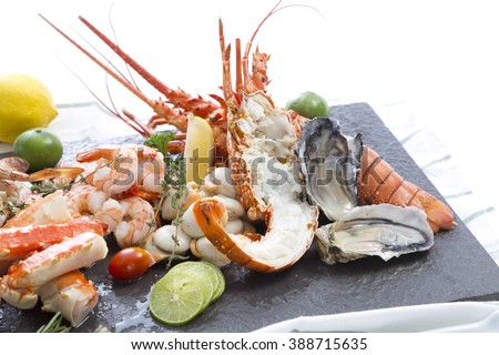 Seafood dish of lobster, prawns, squid, mussels and Alaska King Crab - stock photo