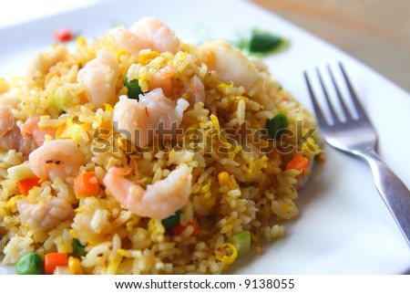 Seafood fried rice with green peas - stock photo
