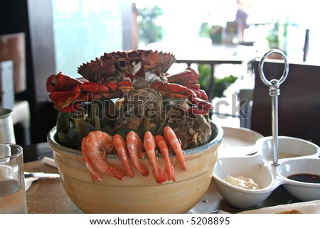 Seafood on ice served in a restaurant with prawns crabs and shellfish - stock photo