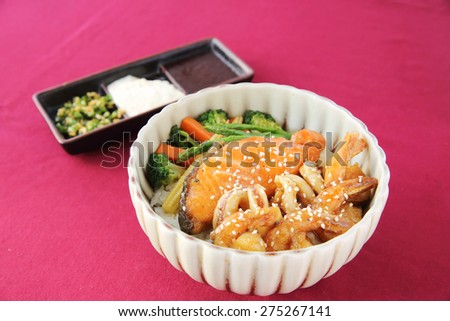 Seafood on rice - stock photo