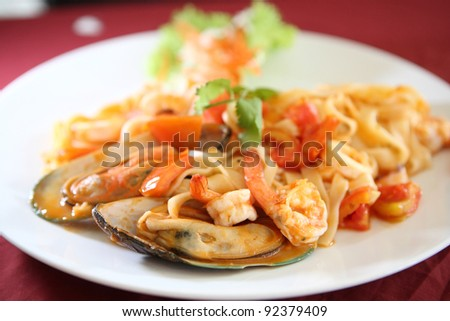 seafood pasta with tomato sauce - stock photo