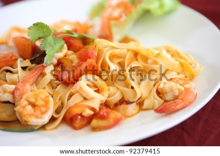 seafood pasta with tomato sauce - stock photo