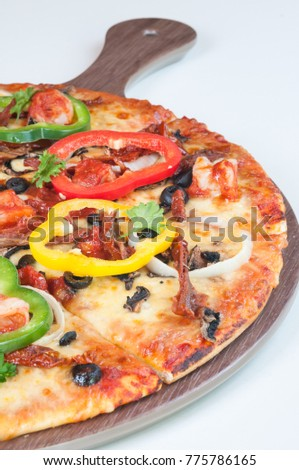Seafood Pizza with bell peppers and sun dried tomatoes