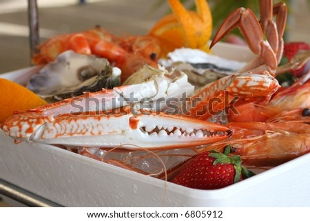 seafood platter at restaurant with oysters scallops mussels crabs - stock photo