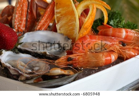 seafood platter at restaurant with oysters scallops mussels crabs