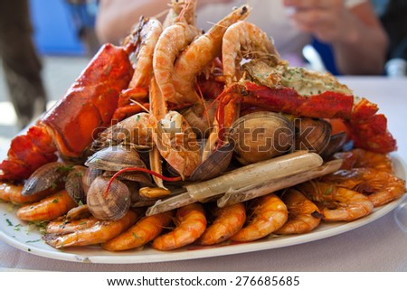Seafood platter. Mix of mussels,clams, shrimps and lobster - stock photo