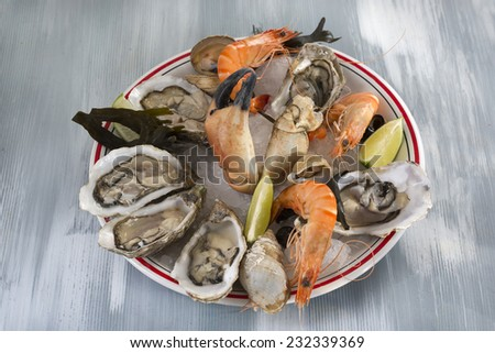 Seafood platter with sydney rock oysters, crab, rock lobster, prawns, mussels, clams and cockles - stock photo