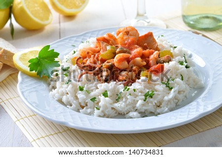 Seafood ragout with rice - stock photo