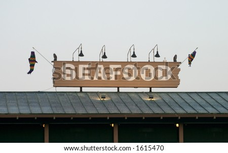 Seafood restaurant sign - stock photo