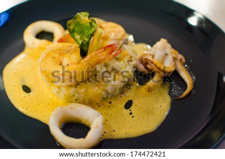 Seafood Risotto with cream cheese sauce - stock photo