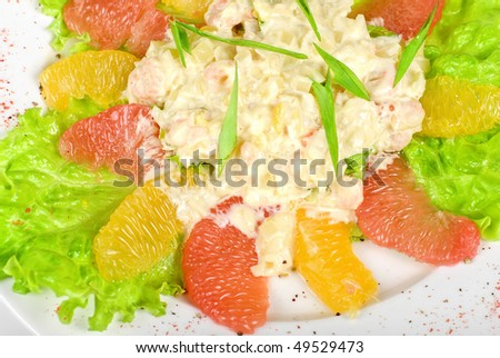 seafood salad of shrimp baked at cream with orange and grapefruit isolated on a white background - stock photo