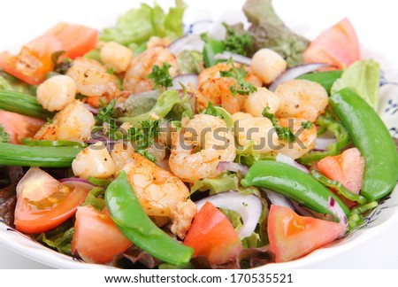 Seafood salad on white background/Seafood salad/A healthy and tasty seafood salad on a white background