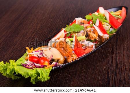 Seafood salad on white plateSeafood salad on a black plate. - stock photo