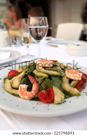 Seafood salad with avocado on a white plate