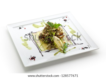 Seafood Salad with Lettuce and Lemon Slice - stock photo