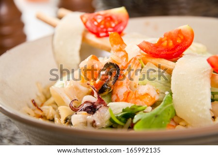 Seafood salad with parmegian and rice