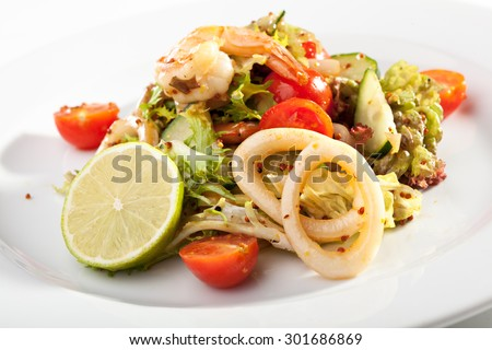 Seafood Salad with Shrimps and Squid Rings - stock photo