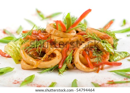 Seafood salad with squid and vegetables closeup - stock photo