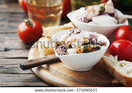 Seafood salad with white wine, selective focus - stock photo