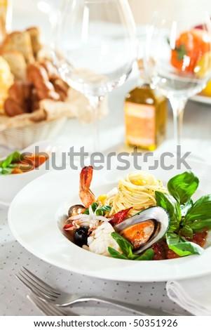 Seafood Spaghetti with Tiger Prawns, Scallops, Mussels, Calamari, Salmon and Tomato Sauce - stock photo